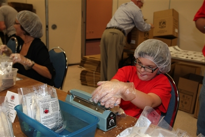 Reagan Chester, 9, packs Stop Hunger Now meals