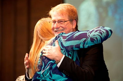 Bishop-elect Carter hug daughter Abby
