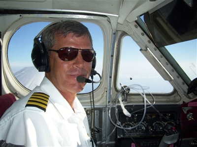 Volunteer pilot Steve Koch in cockpit