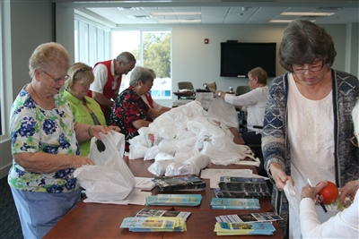 First Lakeland volunteers packing bags for GCFA meeting