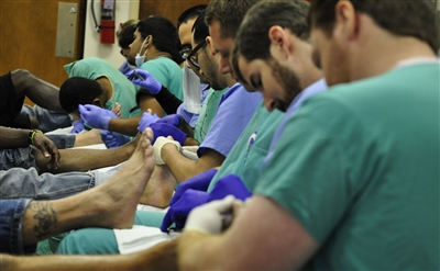Podiatry students and faculty check feet at First UMC, Miami, event