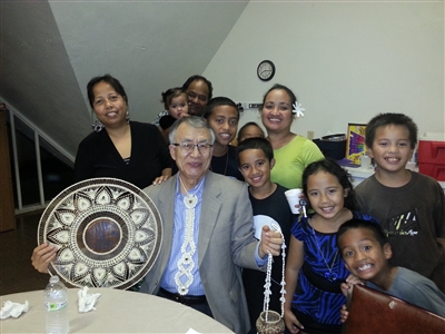 NJ from GBGM surrounded by Micronesians who gave him gifts