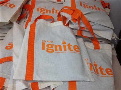 Pile of tote bags with LCI2013 logo