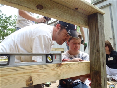 Pastor Russell Clark and Drake Christmas work on mission project