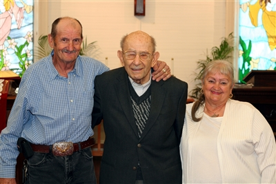 Curtis Spivey, Pastor Haig Medzarentz and Janet Spivey at St. Catherine UMC