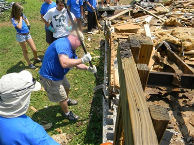 Volunteers recruited by St. James UMC help strip and rebuild a home in West Virginia