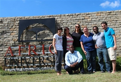 FGCU and CCW campus mission team in front of Africa University sign