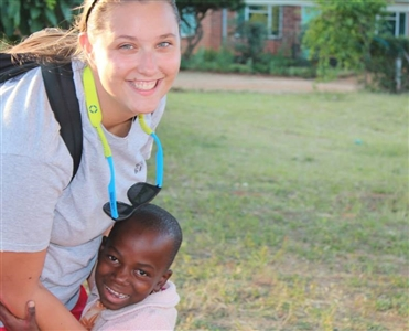 Kaitlyn Brandt visits with an African child