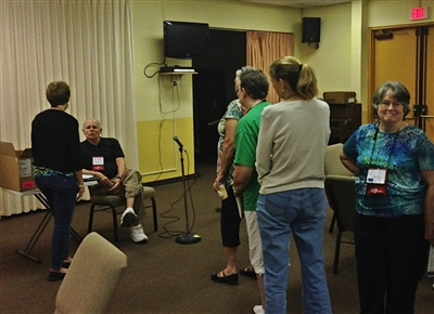 Laity training attendees line up to ask questions of Bishop Dick Wills