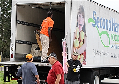 Volunteers at First UMC, Oviedo, unload Second Harvest truck