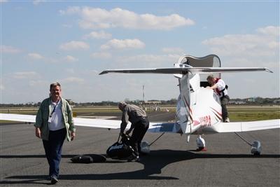 Steve Merrit checks bn Bahamas Habitat pilots on the tarmac