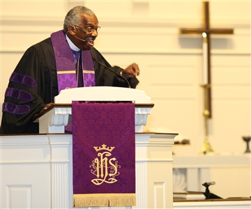 Bishop Adam Jefferson Richardson leads prayer service at Trinity UMC
