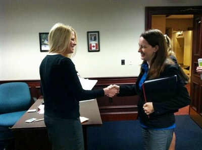 Rev. Beth Bostrom meets with a legislative aide during advocacy event