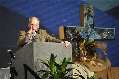 Dr. Bob Tuttle on stage at Annual Conference 2014