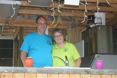 Dave and Donna Bruns in snack hut he built at Centenary Camp