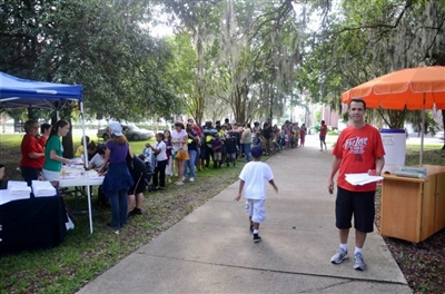 Families line up for Rockin' Back to School at Riverside Park UMC