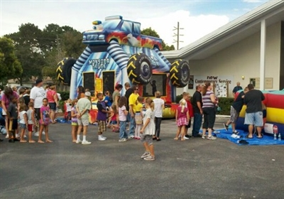 Families lined up in front of a bounce house at First UMC, Spring Hill
