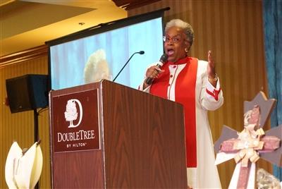 Rev. Dr. Teresa Fry Brown at the opening worship podium