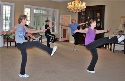 Exercise participants kick high at Trinity UMC