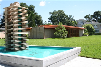 Usonian house and reflection pool pay tribute to Frank Lloyd Wright