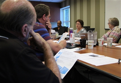 Task force members go over details of mentor training program