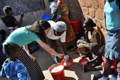 Susan Imes ministers to Zambian people outdoors