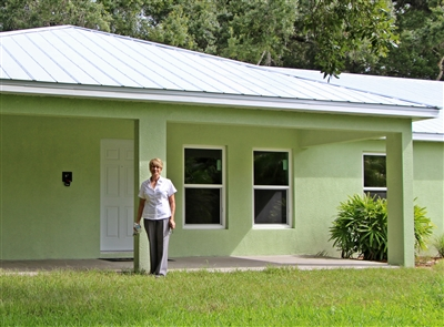 Laura Russo stands in front of newly constructed Russo Ministries center