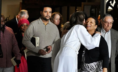 Diverse group of people greeting one another at First UMC, Miami
