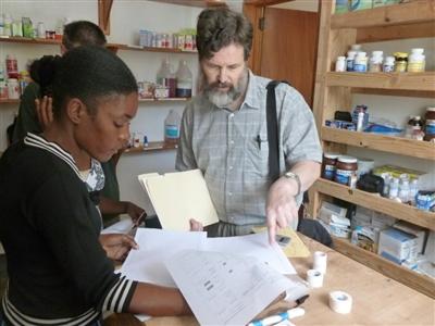 Dr. John Harbottle provides instruction to two Haitian nurses
