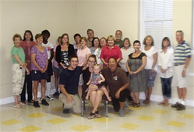 Group photo shows first families to find housing through Family Promise