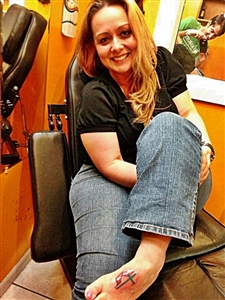 Nicole Pennington shows off her foot tattoo