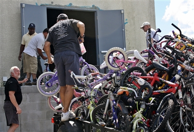 Volunteers at Edgewater UMC bike ministry unload bike donations