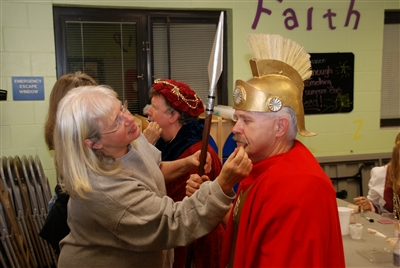 Sherri Taylor of Killearn UMC applies makeup to Roman soldier Ken Tomblin