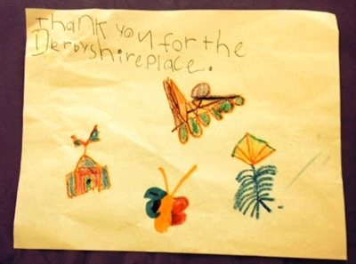 Child's handwriting and drawing expressing thanks to Derbyshire Place