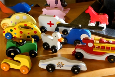 A display of brightly colored wooden toys