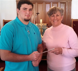 Michael Hatfield receiving check from Mary Lou Short